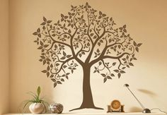 I think I'll paint something like this in my hallway, a very big tree, and hang family pictures in the branches