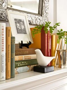 adorable white birds + books for the mantel