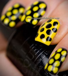 OPI – Black Onyx for the black and Ruby Kisses Yellow Bikini for the yellow.  From My Nail Polish Online