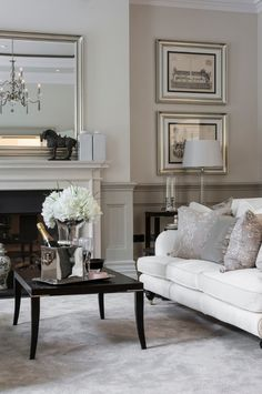 Love the champagne bucket and flowers on the coffee table for guests - from dustjacket attic: Interiors | A London Home