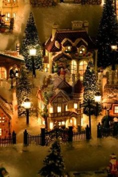 Miniature Christmas Village - remember to create heights using sturdy boxes, then cover all boxes with sheet & add snow after all is set like u want