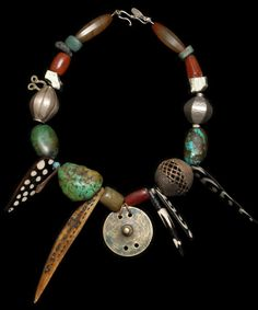 Marion Hamilton - Contemporary pyrite and flourite strung with 19th c. bronze spirals from Nigeria and bronze mini fertility beads from Kenya