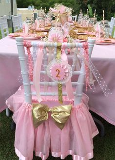 Pretty decorated chair at a pink and gold Minnie Mouse birthday party! See more party planning ideas at CatchMyParty.com!