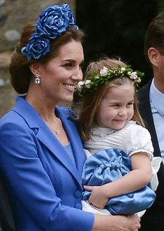 Kate paired the periwinkle coat with a custom-designed headband by Juliette Botterill Millinery. the peice is the latest in a string of more daring pieces by the royal. Estilo Kate Middleton, Kate Middleton Outfits, Princess Kate Middleton, Kate Middleton Style, Pippa Middleton, Prince William Family, Prince William And Catherine, William Kate, Princesa Kate