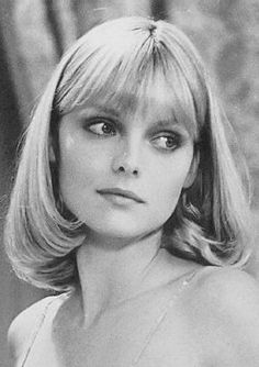 Michelle Pfeiffer as Elvira in the movie Scarface.