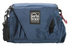 """Porta-Brace Assistant Camera Pouch.  Great for shooting out in the field. It fits everything I need. This ain't no """"fanny-pack""""! (plus there's a shoulder strap if you don't want to use the waist band."""