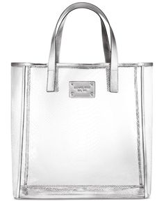 Receive a Complimentary Silver Jelly Tote with any $102 purchase from the Michael Kors fragrance collection