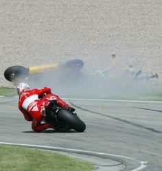 Biaggi and his Honda are sent tumbling through a Sachsenring gravel trap, while Bayliss inherits third.