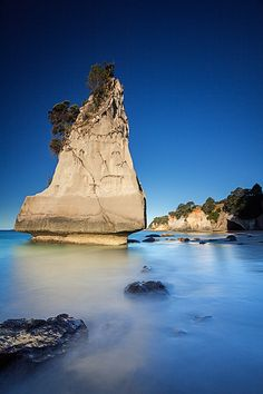 Coromandel Peninsula - North Islandof New Zealand....    We made our way up the Coromandel Peninsula on the North Island and ended up at a place called cathedral cove. Great white cliffs lined the shore with rocky islands popping up everywhere. After walking through a tunnel in the rocks this great big rock, the only piece left standing, greeted us.
