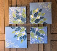 I purchased 4 stretched canvases at the craft store; painted the sides blue to match the paper and glued scrapbook paper for backgrounds on all 4 squares.  My daughter-in-law used her cricuit to cut out petals from the scrapbook paper.  I shoved all the canvases together and glued the petals in a flower arrangement over all canvases. (Some of the petals I had to slice apart when separating the canvases again.)  A couple of layers of modge podge later it was ready to hang on the wall. ~Milda