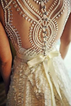 Absolutely love the details on the back of this bridal gown!
