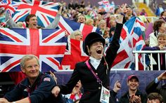 Jubilation: Sophie Christiansen celebrates winning Gold during the Dressage Individual Championship Test Grade Ia  Picture: GETTY IMAGES