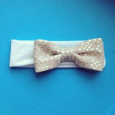 Gold sparkle bow on white jersey knit.  $10 order through Instagram @head_hugs or in the etsy shop! www.headbandsbyheadhugs.etsy.com