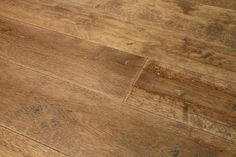 Winchester Antique engineered oak wood flooring with an aged and distressed surface to replicate a reclaimed oak board.