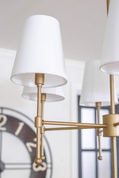 Chandelier Makeover + The Best Brass Spray Paint - Bless'er House The best aged brass spray paint to create a high end designer look on anything easily and inexpensively.  #chandelier #thriftmakeover