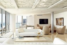 Miami Ocean Palm by @bbhDesignStudio, clean and contemporary space, white and gold decor ,for more inspirations:http://www.bocadolobo.com/en/inspiration-and-ideas/