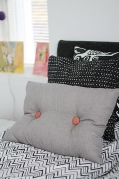 Cushion with big fabric buttons