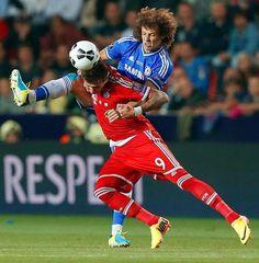 Bayern's Mario Mandzukic of Croatia, front , and Chelsea's David Luiz