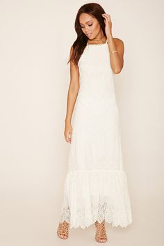 A woven cami maxi dress featuring crochet lace trim and panels, a square neckline, eyelash lace hem and a zipper back.