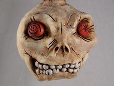 Spooky skull polymer clay ornament Halloween by Sherman Oberson. $38.00, via Etsy.