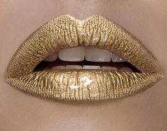 Mehron Pigment in Gold mixed with MAKE UP FOR EVER Eye Seal. I let dry and then applied a thick coat of MAC Lip Glass.