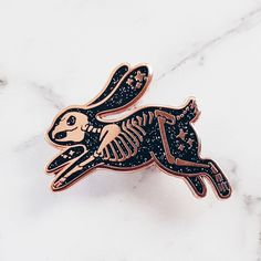 Skeleton Rabbit Hard Enamel Pin | Glitter Pin | Spooky | Starry by LOVEisSOUP on Etsy https://www.etsy.com/listing/560864085/skeleton-rabbit-hard-enamel-pin-glitter