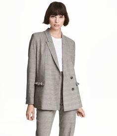 Check this out! Fitted, checked jacket in woven fabric with decorative ruffles. Concealed double-breasted fasteners, welt front pockets, buttons at cuffs, and back vent. Lined. - Visit hm.com to see more.