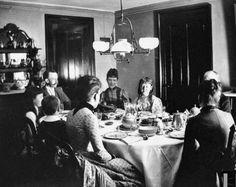 candles atop her birthday cake while surrounded by her family at the dining room table, Brooklyn, New York, February 5, 1888