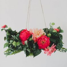 Make you own flower chandelier using Afloral silk products and it'll last forever! So pretty to hang over your dining room table.