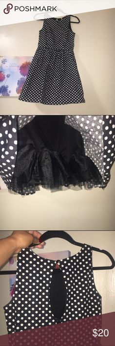 Poka dot dress! Black and white poka dot dress. Has an underlining puff as shown in pic and a peep hole on the back. Very cute and could be used for a vintage party or any type of event 😍 Dresses Mini
