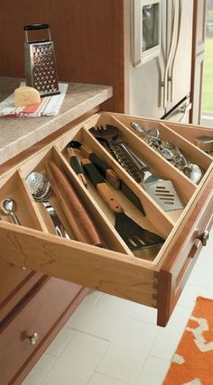 Diagonal boards in your drawers help keep cutlery organized.