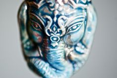Hey, I found this really awesome Etsy listing at https://www.etsy.com/listing/89829004/ganesh-head-necklace-raku-style-peruvian