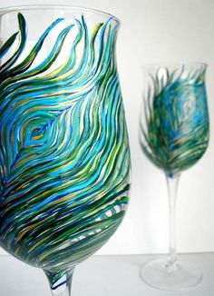 Peacock Wine Glasses... Jess - thinking of you and wedding stuff - perhaps for the girls to drink out of @ the head table. A crafty/artsy person (ie: your mother in law) could do something similar on beer mugs for the boys ....