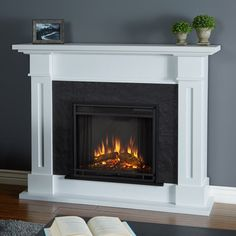 Real Flame Kipling Electric Fireplace in White - clean lines and a textured faux slate firebox surround, the Kipling Fireplace features authentic craftsman appeal, suitable for virtually any space. The Vivid Flame Electric Firebox plugs into a Gel Fireplace, Fireplace Mantels, Fireplace Ideas, Vent Free Gas Fireplace, Mounted Fireplace, White Fireplace, Fireplace Screens, Fireplace Design, White Electric Fireplace