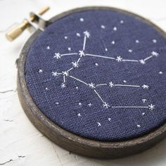 """the twins"" constellation embroidery  I love this idea, what a good way to teach kids the constellations. - - - love it on the denim :)"