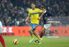 Albin Ekdal of Sweden and Antoine Griezmann of...