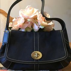 Black Coach shoulder bag Black Coach shoulder bag in new condition. This bag is a medium size bag and has a pocket in the back and a few inside. This is a great bag but too small for me. My loss is your gain! Coach Bags Shoulder Bags