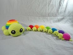 Rainbow Mama turtle and Rainbow Tiny-er Turtles - free crochet patterns by Duchess Gala.