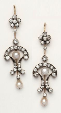 A pair of Belle Epoque gold, silver, pearl and diamond earrings, circa 1910. #BelleEpoque