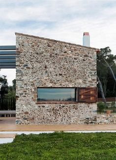 16th century hay loft becomes modern stone house in Spain