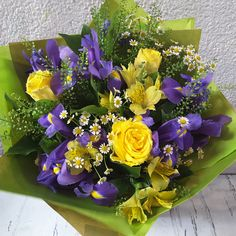 #Seasonal, #Spring #flower #handtiebouquet of #Iris, yellow #Roses and #Alstromeria, #Chamomile and #Thlaspi.