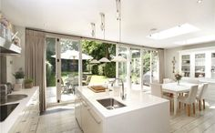 Open plan kitchen living room joining the back porch.what a great way to invite a feel of open doors and nature to a modern rustic kitchen. Kitchen Design Open, Open Plan Kitchen, Kitchen Ideas, Kitchen Family Rooms, Living Room Kitchen, Dining Room, Kitchen Diner Extension, Kitchen Extension With Bifold Doors, Kitchen Bifold Doors