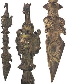 Asian. Solid bronze ceremonial spear with highly decorative blade with geometric patterns. Dragons on the upper edge with three crowned heads, a center horse on the top of their crowns, the lower edge with three dragon faces on three sides with a handle in the center. Light green patina. 1700 AD