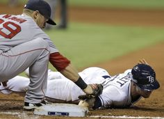Boston Red Sox right fielder Daniel Nava (29) tags Tampa Bay Rays' Ryan Brett out at first on a pick off move from starting pitcher Wade Miley during the third inning of a baseball game Tuesday, April 21, 2015, in St. Petersburg, Fla. (AP Photo/O'Meara)  Boston Red Sox Team Photos - ESPN