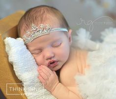 Every little princess needs a crown! Our adorable tiara/crown headband features sparkling rhinestone jewels and permanently attached to a sparkly silver stretch headband that will be a real head turner. SHOP fancy newborn headbands at http://thinkpinkbows.com/products/jewels-in-my-crown-headband | Shabby Chic | Baptism | Christmas | Vintage | Baby Shower Gift