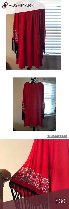 NWT PLUS SIZE Flutter Sleeve top tunic NWT PLUS SIZE (marked 3X fits like a 2X) Flutter Sleeve top tunic PAID $49.99 Red tribal or western pattern Would be cute with leggings. Very stretchy material.  Smoke free but pet friendly home. LilyPad Tops Tunics