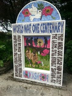 Well dressing in Monyash, Derbyshire. Made from flowers, leaves and natural objects.