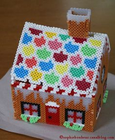 3D Gingerbread House hama perler beads by Aux petits bonheurs de Sophie. Pattern: http://www.eksuccessbrands.com/perlerbeads/Projects/3-D_Gingerbread_House.htm