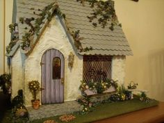"My miniature dollhouse bakery that I made.  It started as a kit that I ""kit bashed"".  I had so much fun with the landscaping, maybe too much...lol"