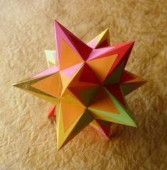 Beautiful paper star! We can see a group of these as a stunning hanging display. (Instructions and pattern included.)